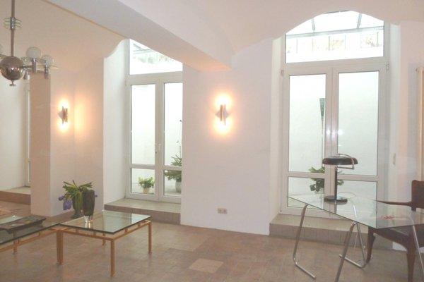 Atelier mit Wintergarten Schwabing, stylish - Blick zum Wintergarten