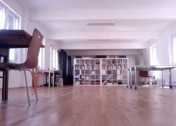 Amply. Loft with hardwood flooring